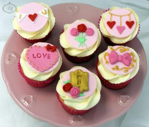 Valentine's cupcakes with red, pink and gold detailing
