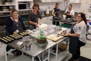 Staff group photo in kitchen