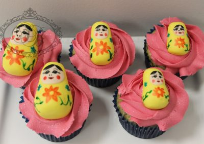 Babushka doll cupcakes with pink rose swirl buttercream