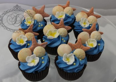 Sea shell cupcakes with blue buttercream