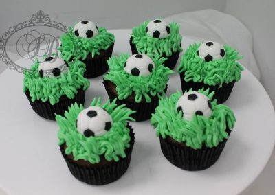 Soccer ball cupcakes with grass buttercream