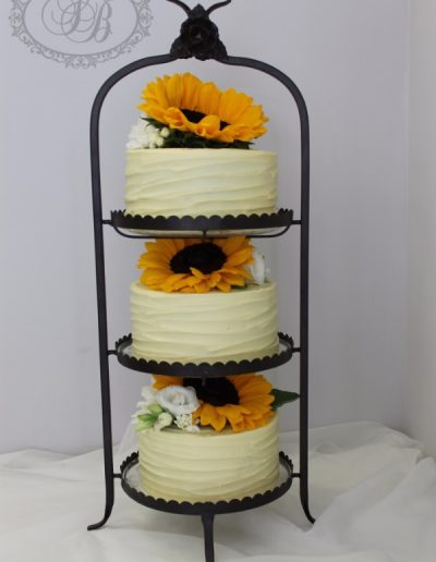3 layered white chocolate ganache wedding cake with sunflowers