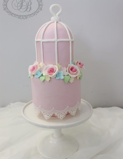 Pink birdcage wedding cake with sugar flowers