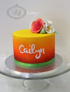 Sunset airbrushed cake with tropical flowers