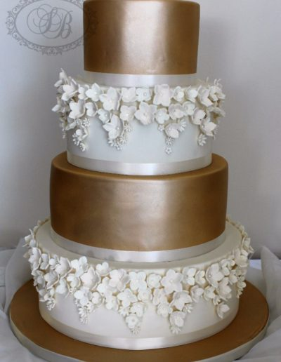 Bronze and white blossom fade wedding cake