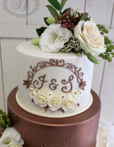 Rose gold monogram wedding cake with fresh and sugar flowers