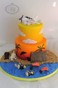 2 tier sunset sky cake with ocean iced board