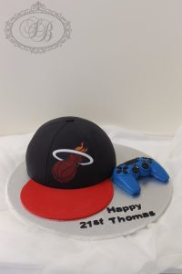 Basketball cap and Playstation controller cake