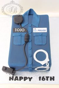 3D police officer shirt cake with handcuffs