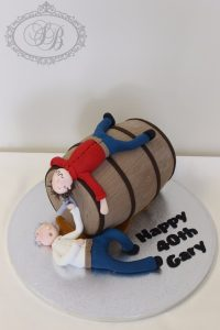 3D wine barrel cake with figurines