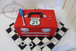 Red toolbox cake with checkered iced board