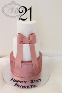 21st cake with pink glitter and fondant bow