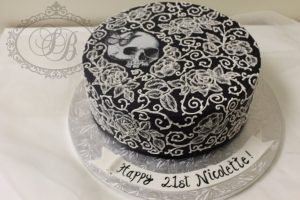 Black gothic style piped detail cake