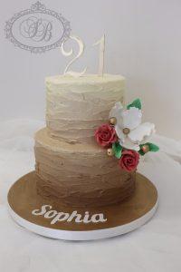 2 tier beige buttercream cake with flowers