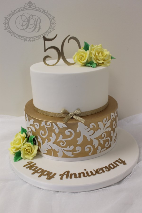 2 Tier 50th Birthday Cake With Gold And Yellow Flowers