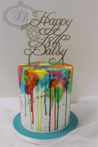 Tall single tier cake with colourful watercolour drip effect