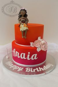 2 tier orange to pink ombre cake with fondant figurine