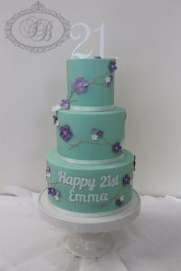 3 tier mint coloured cake with piped purple blossoms
