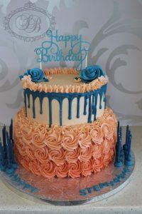 Orange and blue buttercream drip cake
