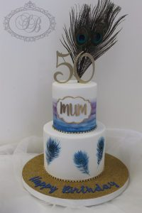 2 tier peacock feather cake
