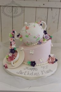 Topsy turvy teapot cake with sugar flowers