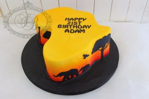 3D Africa shaped cake with sunset airbrush and silhouettes