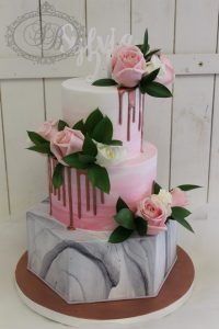 3 tier round and hexagon cake with marble and rose gold