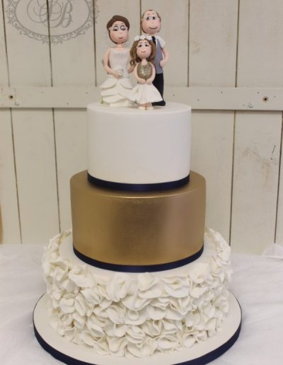 Navy, gold and white ruffle themed wedding cake