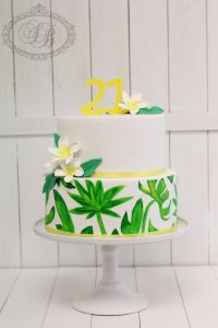 2 tier cake with painted tropical leaves and frangipani