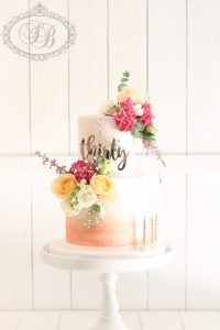 2 tier peach watercolour cake with fresh flowers