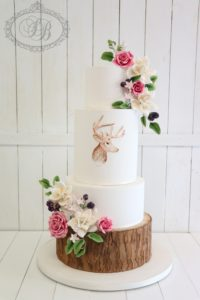 Woodland theme wedding cake with log effect tier