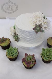 White royal icing wedding cake with succulent cupcakes