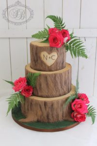Realistic log effect 3 tier wedding cake