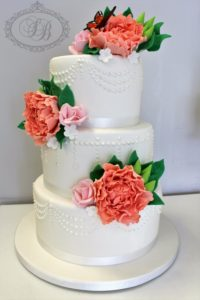 Pearl piped wedding cake with peach peonies