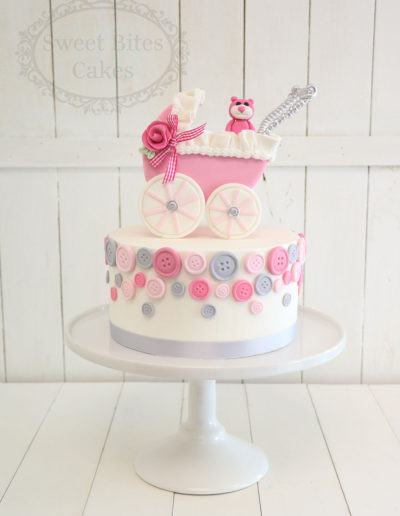 Pink pram and buttons cake