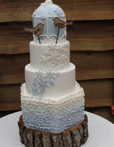 Baby blue bird cage wedding cake