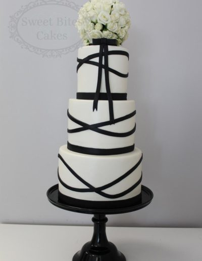 Black and white cake with fresh flower ball