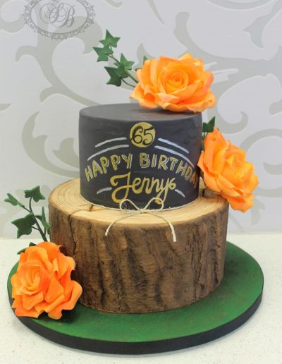 Log and chalkboard cake with orange roses