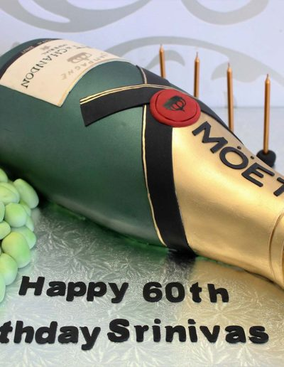 3D champagne bottle cake with grapes
