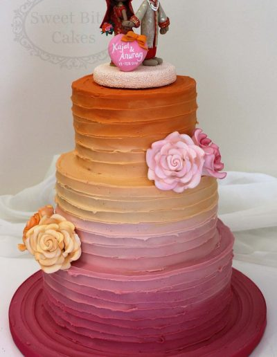 Orange to pink ombre wedding cake