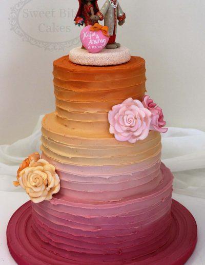 Orange to pink ombre wedding cake