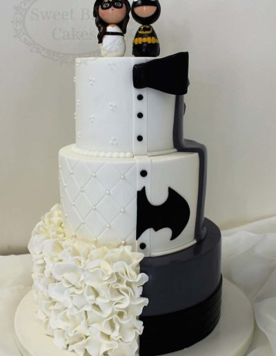Half classic half batman wedding cake