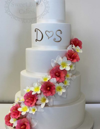 5 tier white wedding cake with monogram