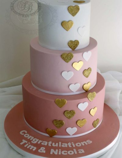 Pink and white ombre wedding cake with hearts