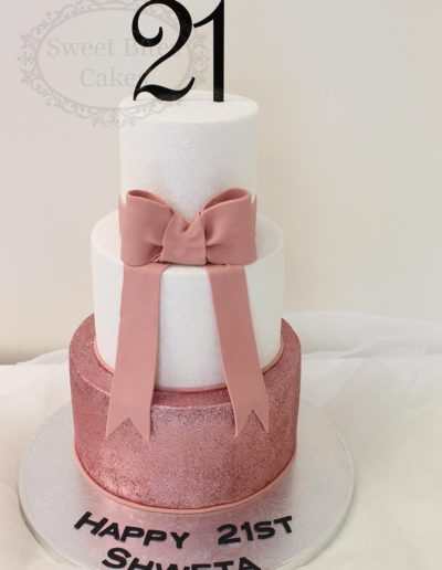 Pink glitter and sugar bow cake