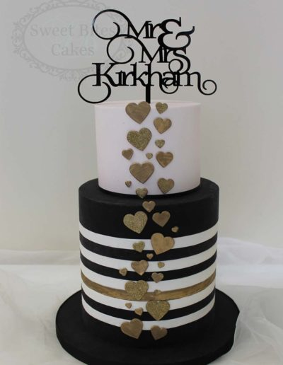 Pink, gold and stripes wedding cake