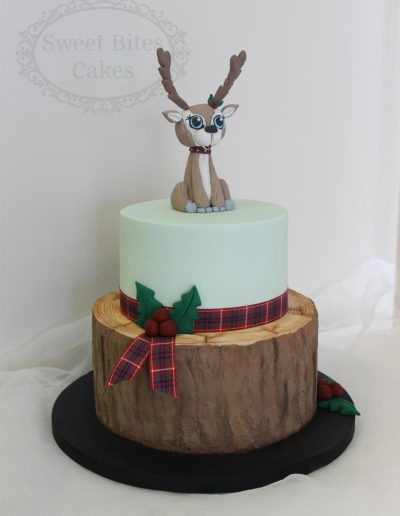 Realistic log cake with deer topper