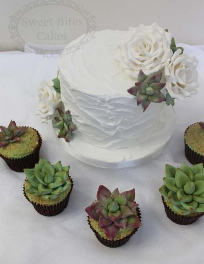 Royal iced wedding cake with succulents cupcakes