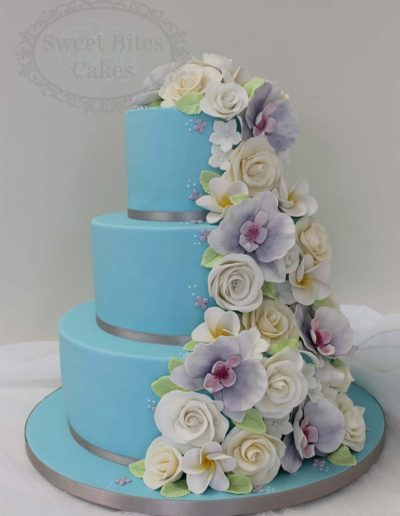 Blue wedding cake with flower cascade