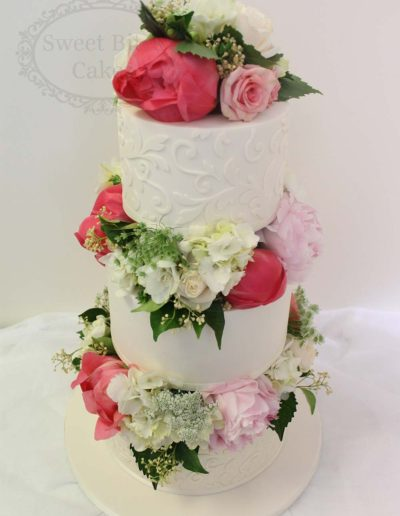 3 tier flower blocked wedding cake